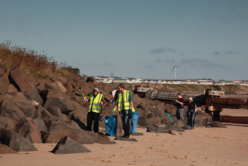 Volunteers Pick Up Rubbish In The Strand Line