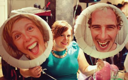 Our faces on balloons that we sent to our friends wedding