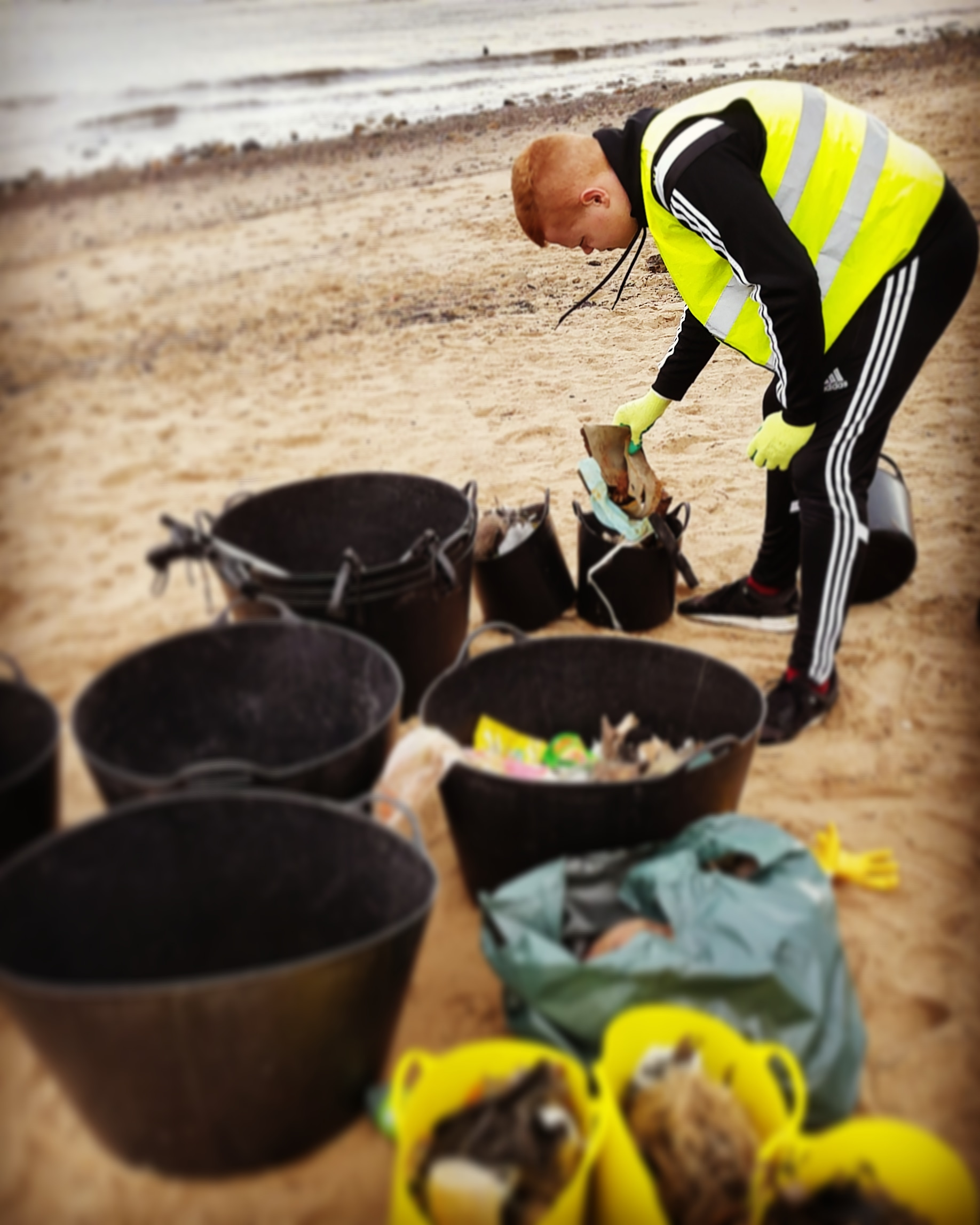 Harry sorting the beach clean trash